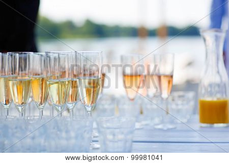 Glasses With Champagne And Wine On Summer Wedding