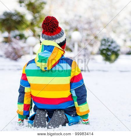 Portrait Of Little Boy In Colorful Clothes In Winter, Outdoors