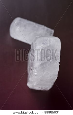 Two Ecologic Deodorant Crystal In Dark Red Background