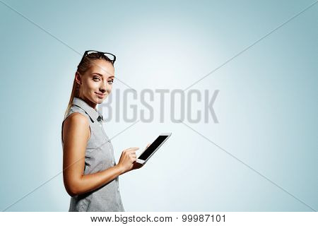 Closeup Portrait Of Happy Young Blonde Business Woman Using Tablet Pc Isolated On Green Background.