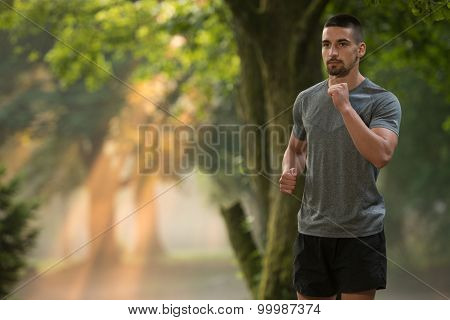 Young Man Running Outdoors On A Lovely Day