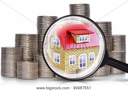 Coins, A House And A Magnifying Glass