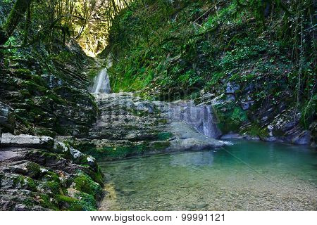 Wonderful waterfall among the rocks in mountain forest