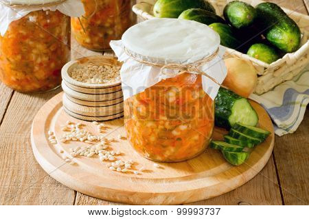 Preserves Pearl Barley, Cucumber, Pickle In The Bank On A Wooden Background