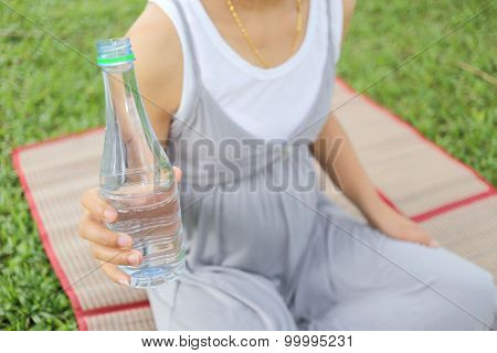 Pregnant Women Have A Water Bottle In Hand.