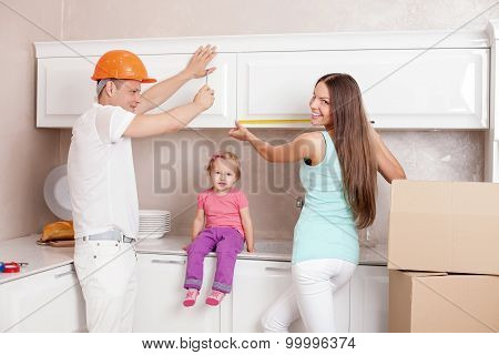 Pretty young family is packing things before moving