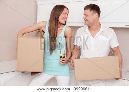 Cheerful young married couple is preparing to move