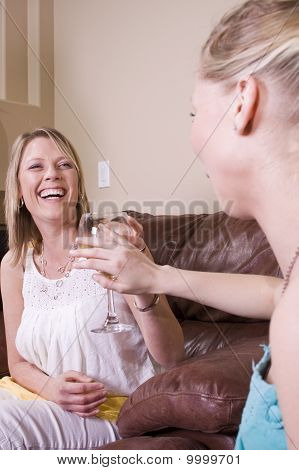 Mother Offering A Drink To Her Daughter