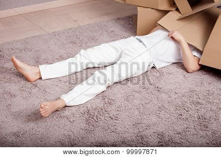 Young man is resting in process of packing