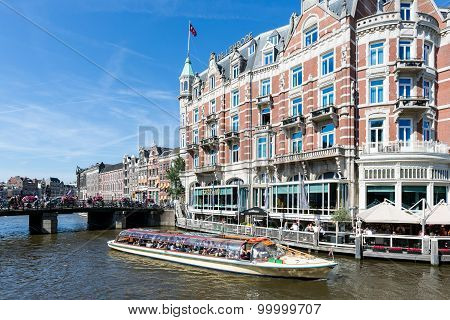 Excursion Ship With Tourists In Amsterdam Canal