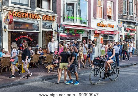 Tourists In Amsterdam Looking For A Restaurant