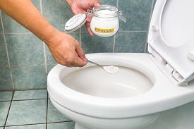 stock photo of disinfection  - Baking soda used to clean and disinfect bathroom and toilet bowl - JPG