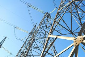 stock photo of electricity pylon  - Electricity pylons and lines background - JPG